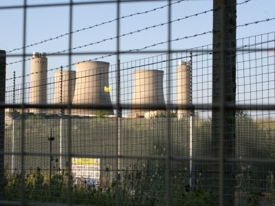 cooling towers behind bars